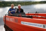 1 SIS User Laura Torrance uses adaptive equipment in powerboat w Renfrewshire Provost Anne Hall