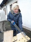 Eileen building birdboxes at Branching Out Greenock Cut Centre